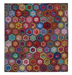 Kim's Glorious Garden.  Frame of EPP hexagons with large scale print in center.
