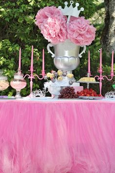 Royal Princess centerpiece & pink tulle skirt make this princess table complete  #quinceanera