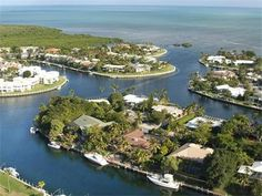 Great Ocean Reef family home offering four bedrooms, three baths, and expansive dockage. The pool patio offers great entertaining space with southeast exposure, several seating areas and bar area. This canal front property offers 128+ water frontage allowing for an 80+ ft. vessel and quick access to the ocean or bay.
