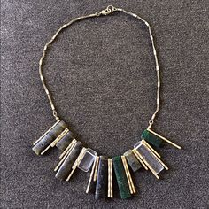 Anthropologie Necklace Gold & stone (black, grey, dark green, clear) statement necklace by Anthropologie. Chain has tarnished some (see up close pic). If offering less, please consider bundling. Anthropologie Jewelry Necklaces