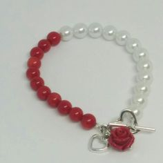 """Red and White Beaded Bracelet with Red Rose and Heart Charms measures 6 3/4"""""""