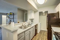 Our renovated apartment homes are equipped with black appliances, updated cabinetry, brushed nickel lighting, and washers and dryers. Black Appliances, Dryers, Washers, Brushed Nickel, Double Vanity, Las Vegas, Homes, Lighting, Kitchen