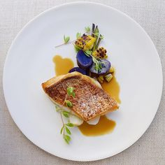 Crispy skin red snapper, purple potato, grilled corn, young spring onion, coconut ginger lemongrass dashi broth