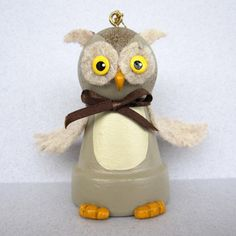 This little Owl Bell is about 2 3/4 tall and has a bell inside. He is made from a small clay flower pot. His wings, ears and tail are made from felt. His toes and beak are made from clay. Great as a gift for a friend for Halloween. All of my ornaments are original creations. Thanks for checking out my shop.