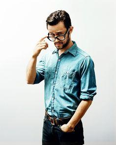 joseph gordon levitt's glasses, beard and chambray/denim.