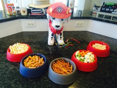 Paw Patrol birthday party! Snacks in dog bowls from the dollar store. Marshall piñata from Party City. #pawpatrol