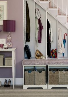 Or perfect little cubby holes for everyone in your family. | 27 Genius Ways To Use The Space Under Your Stairs
