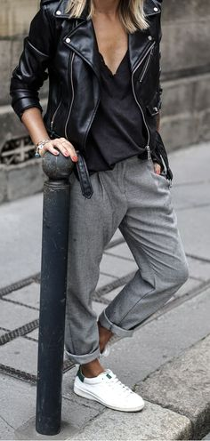 belted leather trousers. grey loose trousers. sneakers.