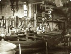 A boat-builder inside his shop with frame of a small boat. EW Carter photo ca. 1900.....   people today have no idea what real CRAFTSMEN really did. that boat may still be around today. Now think about some of the cars that you have had. do they last 100 years???