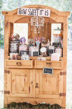 candy bar  needs some lace touches and greenery flowing from the top of hutch to the ground/ volusiacountyweddings/ www.callaraesfloralevents.com