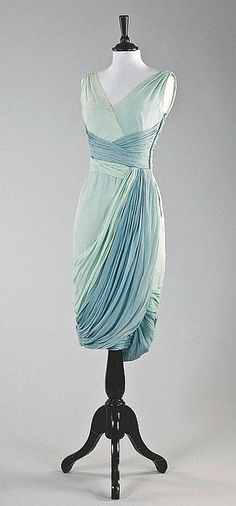 A Jean Dessès draped chiffon cocktail gown, late 1950s, bearing Paris pret a porter label and Canadian retail label, in aqua and pale blue chiffon, lightly boned integral corseted bodice, bust 82cm, 32in, waist 59cm, 23in