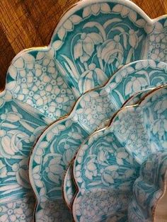 Turquoise, white and gold on china plates