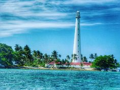 from - The Lighthouse Island Belitung, Sky Landscape, Lighthouses, Cn Tower, Statue Of Liberty, Paradise, Traveling, Island, Sea