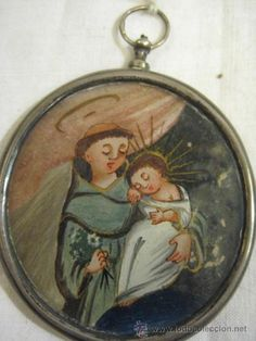 Pequeño relicario de plata con San Antonio de Padua por una cara y por la otra El Santo Rostro - Foto 1