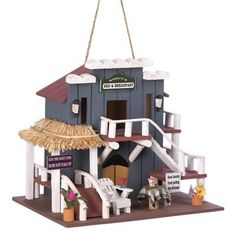 DSHD - Bed And Breakfast Birdhouse    Rock and roll roadhouse brings back the good old times of the fifties! Charming lifelike details including a miniature burger and milkshake make this bird palace a fanciful addition to your garden. Clean-out hole on back. Hanging loop at top.