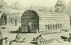 """Iroquois Longhouse - Established in either 1142 or 1451, the Five Nations Iroquois confederacy consisted of the Mohawks, the Oneidas, the Onondagas, the Cayugas, and the Senecas. When the Tuscaroras joined in 1712 the union adapted the name Haudenosaunee, which translates to mean """"six separate Indian nations"""".  In treaties and other colonial documents they were known as the """"Six Nations."""""""