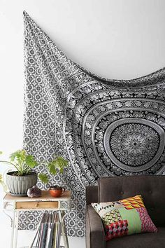 Mesmerizing medallion tapestry crafted in soft woven cotton exclusively for UO, from Magical Thinking. Instantly adds a unique touch of boho charm to any living space or dorm room. Doubles as a beach or picnic blanket and is festival-friendly, too!