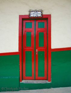 A typical brightly painted front door of a house in Salento, Quindio, Colombia Big Doors, Closed Doors, Windows And Doors, When One Door Closes, Antique House, Unique Doors, Painted Doors, Home Signs, Exterior Doors