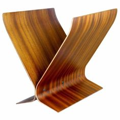 Bent rosewood pieces, layered and finished with a mahogany veneer, lend this piece a warm richness that hasn't faded a bit since it was constructed in the 1960s. For more information, contact Assemblage.