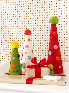 Great as a centerpiece or mantel or foyer decoration, these yarn-covered trees will add a colorful pop to any room. Get crafting now to make your own.