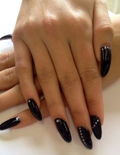 Black almond shape gel nails with silver dots by The Henhouse in Cochrane Alberta Canada 403-932-4640.