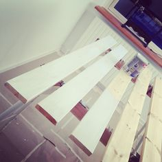 Cheap wood. White paint. Shelves.