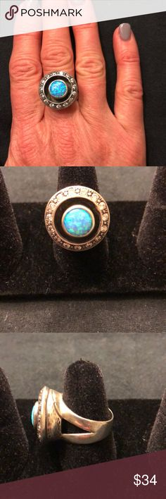 Sterling silver and opal ring Sterling silver and opal ring with cubic zirconia stones in circular fashion around opal. Purchased in Mexico. Beautiful piece!! Jewelry Rings