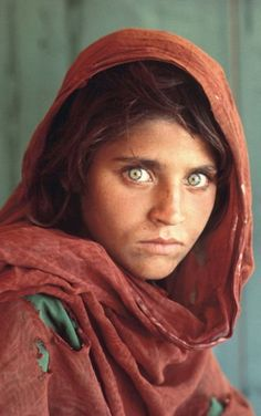 Steve McCurry - Famous Photo Afghan Girl with Green Eyes