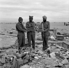 Indian troops hold up a swastika captured in Libya, November 1941