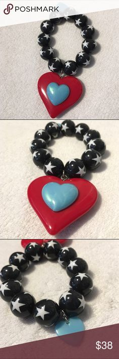 Tarina Tarantino star and heart beaded bracelet Stretch bracelet with black with white star beads. Large red heart dangles down with small aqua blue heart. NWOT Tarina Tarantino Jewelry Bracelets