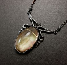 Rutilated quartz and mother of pearl doublet cab silver by KAZNESQ