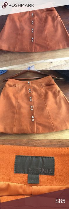 Suede skirt Gently worn, good condition. Flattering. Looks great with tights and high boots intermix brand. Orange suede. Skirts