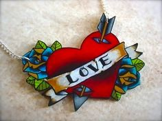 customizable cupids lover tattoo blood red heart with bright blue roses necklace. $26.00, via Etsy.