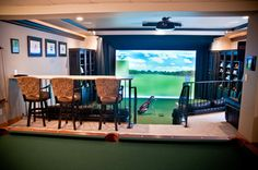 River Glen Basement Expansion - Golf Simulator - eclectic - basement - indianapolis - The WAIRE Group