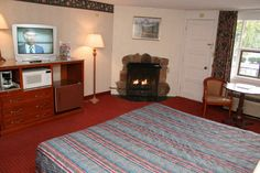 Our Deluxe Queen Hotel Room with Fireplace offers a private Balcony - River Edge Motor Lodge in Gatlinburg - For more info click here - http://www.hotel-gatlinburg.com/rooms.html