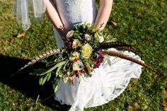 Unique bridal bouquet with pheasant feathers | April and Bryan Photography