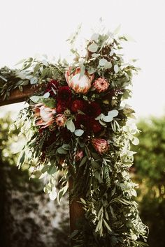 Lush florals of crimson & pink | Image by Lauren Scotti Photography