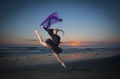 Jumping dancer at the beach at sunset CA