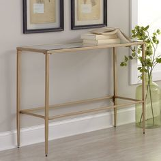 A glamorous mix of clear tempered glass and brushed gold and silver finished metal, the look of this console table is both airy and luxe.
