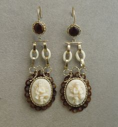 Late Victorian 9k drop earrings with white carved coral