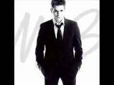 Michael Buble - Quando Quando Quando.  A great selection for cocktail hour, with lovely backup vocals by Nelly Furtado