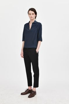 Simple silhouette, neutral colours of black and navy.