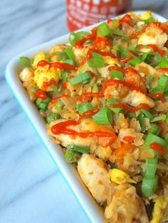 "Sriracha Chicken Cauliflower Fried Rice - The Lemon A healthy spin on the take-out classic, your entire family will love this chicken cauliflower ""fried rice"" - with or without the Sriracha! 270 calories for 2 cups serving! Paleo Recipes, Asian Recipes, Low Carb Recipes, Cooking Recipes, Rice Recipes, Paleo Food, Vegetable Recipes, Dinner Recipes, Dessert Recipes"