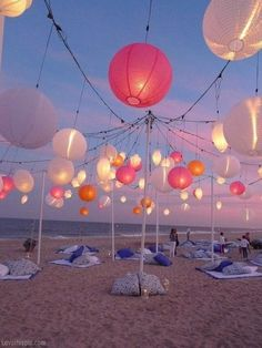 beach party inspiration - love the lantern lighting and ground seating. How fun!