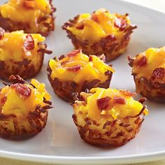 Bite-Sized Breakfast - The Pampered Chef? Love this idea for Easter brunch. Just press thawed hash browns into a mini-muffin tin, fill with your favorite breakfast foods, and bake at for 22 - 25 minutes or until golden brown. Breakfast Cups, Breakfast Recipes, Hashbrown Breakfast, Breakfast Sausages, Lunch Recipes, Pampered Chef Recipes, Cooking Recipes, Muffin Tin Recipes, Muffin Tins