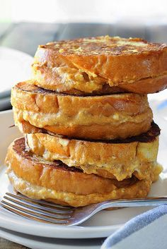 This pumpkin cream cheese french toast is a fun way to celebrate pumpkin season! With a cheesy pumpkin filling and all french toast flavors you love. What's For Breakfast, Breakfast Dishes, Breakfast Recipes, Breakfast Casserole, Pumpkin Recipes, Fall Recipes, Tostadas, Brunch Recipes, Dessert Recipes