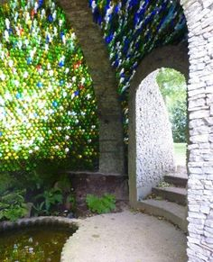 This beautiful dome shed roof has been created using 5000 glass bottles, and was designed by JRR Tolkien Wine Bottle Wall, Bottle House, Bottle Garden, Wine Bottles, Glass Bottles, Shed Of The Year, Earthship Home, Bottle Trees, Natural Building