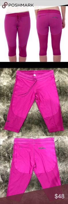 Adidas By Stella McCartney 3/4 Studio Tights Great condition! One small run in the fabric on the right leg but it's hardly noticeable. Laying flat the waist measures 16.5 and inseam is 17. Fuschia pink. Adidas by Stella McCartney Pants Leggings