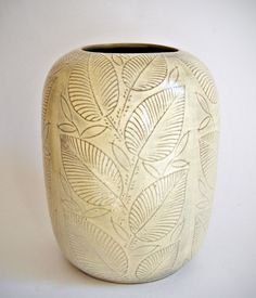 "A rare sgraffito vase from a small series of vases from 1943/44, named ""Løvspring"", by Nils Thorsson. Made at Aluminia, an earthenware factory run together with The Royal Copenhagen Porcelain Factory. Due to the situation under the war there was a shortage of raw materials and Thorsson sought to come up with alternative materials. This series is made from red clay. The items came with glazes in various colours: Yellow, brown, green and blue over a scraffito decoration."