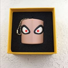 Rare Fendi USB drive (3.80 GB). Monster eyes with keychain and original box. Marked Snobius on the bottom and Fendi Roma on the back. Fendi marketing PDFs (2) on the drive - fully functioning.